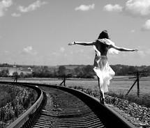 balance,black,and,white,dress,girl,photography,rails,railway,tracks,walking,woman-e3b0a57db379f7e933dd1f0153e4aaea_m