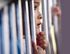 kid behind bars