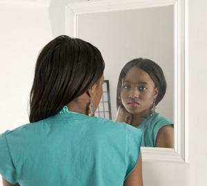 black-girl-looking-in-the-mirror